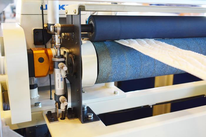 long lasting Urethane roller on SKB double serging machine.JPG