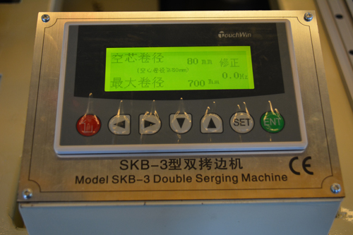 Touch screen control panel on SKB double serging machine.jpg